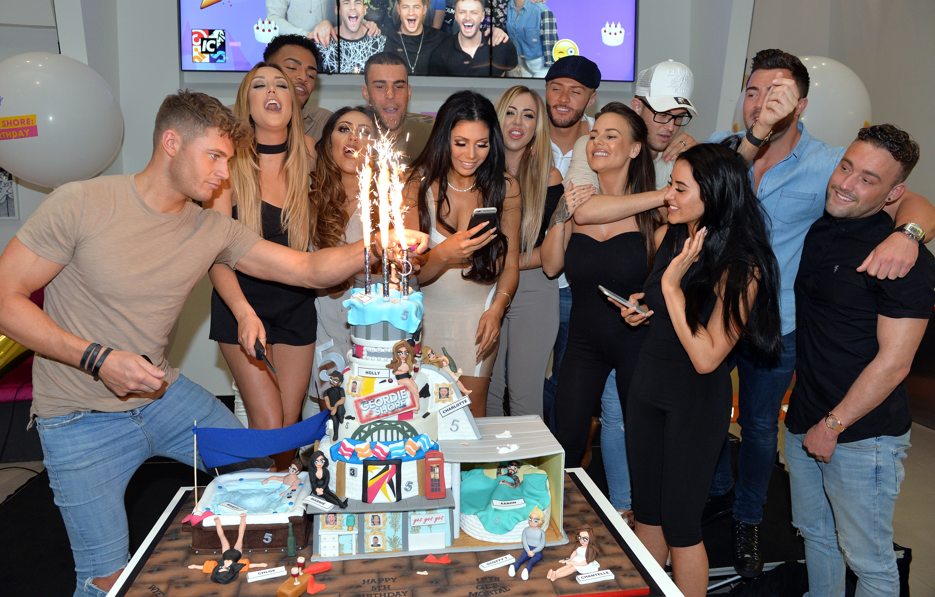 LONDON, ENGLAND - MAY 24: Charlotte Crosby, Holly Hagan, Chloe Etherington, Chantelle Connelly, Marnie Simpson, Sophie Kasaei, Aaron Chalmers, Nathan Henry, Scott Timlin, Marty McKenna, James Tindale and Dan Thomas-Tuck of tGeordie Shore celebrate their fifth birthday at MTV London on May 24, 2016 in London, England. (Photo by Anthony Harvey/Getty Images) *** Local Caption *** Charlotte Crosby; Holly Hagan; Chloe Etherington; Chantelle Connelly; Marnie Simpson; Sophie Kasaei; Aaron Chalmers; Nathan Henry; Scott Timlin; Marty McKenna; James Tindale; Dan Thomas-Tuck